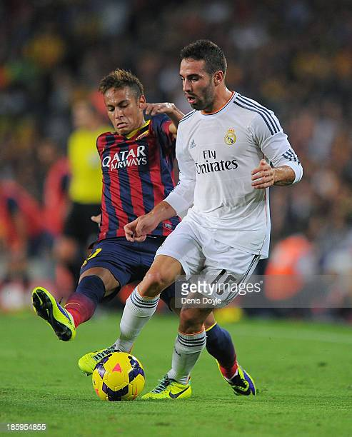 Neymar of FC Barcelona and Daniel Carvajal of Real Madrid CF contest the ball during the La Liga match between FC Barcelona and Real Madrid CF at...