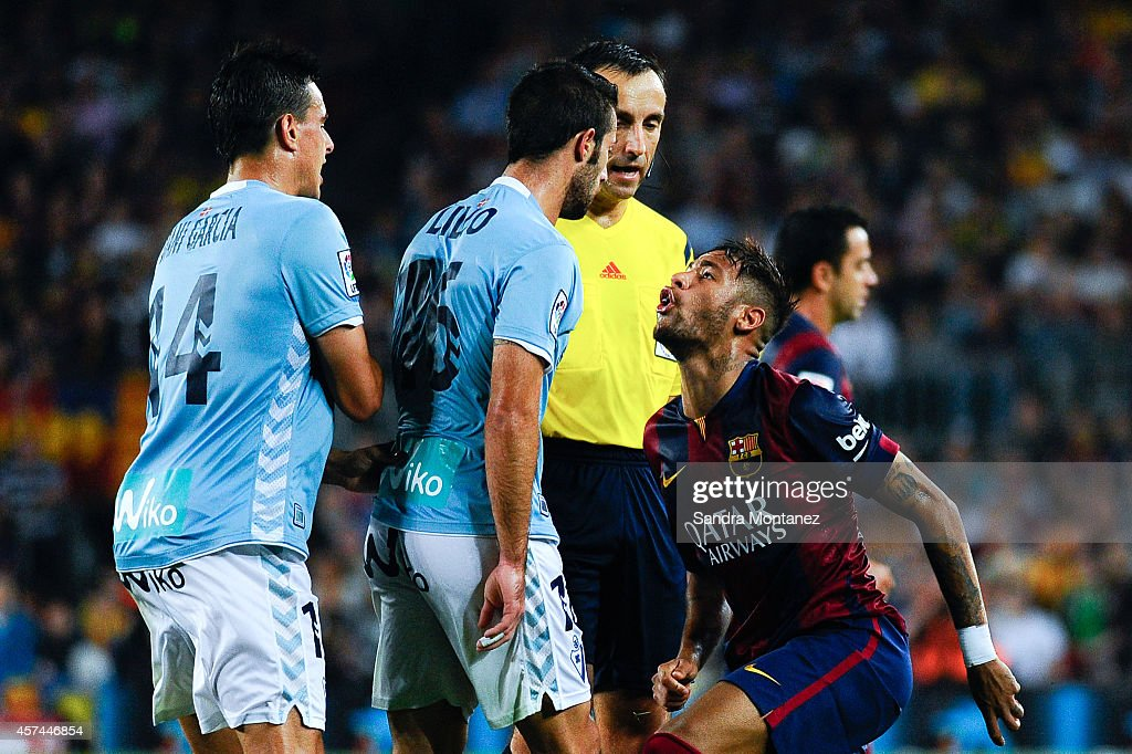 Neymar of FC Barcelona argues with Manuel Castellano 'Lillo' (C) of SD Eibar during the La Liga match between FC Barcelona and SD Eibar at Camp Nou on October 18, 2014 in Barcelona, Spain.