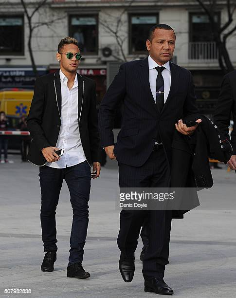 Neymar of FC Barcelona arrives at the National Court accompanied with his father Neymar da Silva Santos on February 2 2016 in Madrid Spain Neymar is...