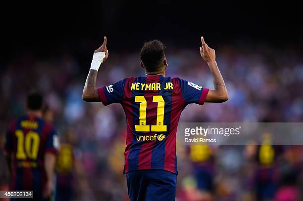 Neymar of FC Barcelona celebrates after scoring his team's fifth goal during the La Liga match between FC Barcelona and Granada CF at Camp Nou on...