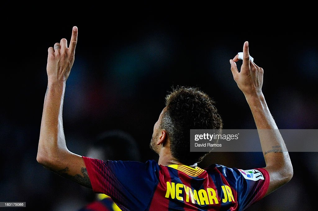Neymar of FC Barcelona celebrates after scoring his team's fourth goal during the La Liga match between FC Barcelona and Real Valladolid CF at Camp Nou on October 5, 2013 in Barcelona, Spain.