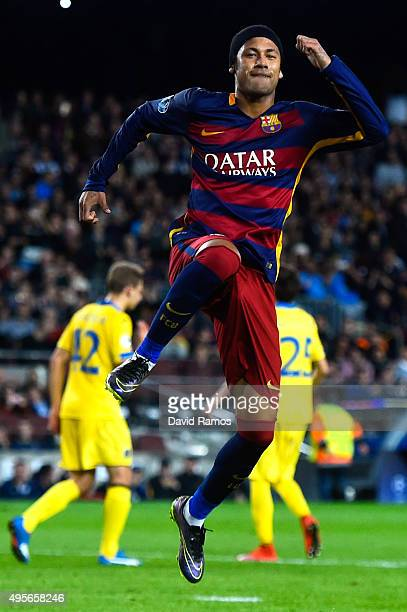Neymar of FC Barcelona celebrates after scoring the opening goal from the penalty spot during the UEFA Champions League Group E match between FC...