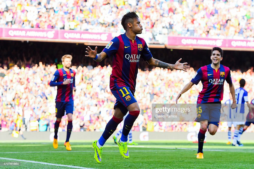 Neymar of FC Barcelona celebrates after scoring the opening goal during the La Liga match between FC Barcelona and Real Sociedad de Futbol at Camp Nou on May 9, 2015 in Barcelona, Spain.