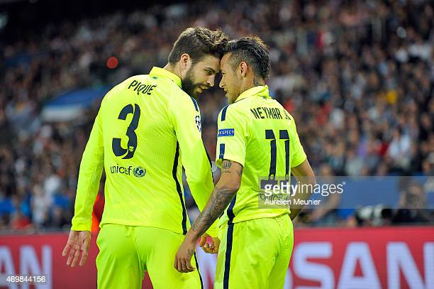 Neymar of FC Barcelona celebrates his goal with his teammate Gerard Pique during the UEFA Champions League Quarter Final First leg between Paris...