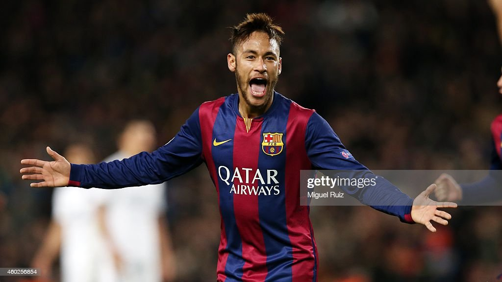 Neymar of FC Barcelona celebrates scoring the second goal during the UEFA Champions League match between FC Barcelona and Paris Saint-Germain at Camp Nou on December 10, 2014 in Barcelona, Spain.