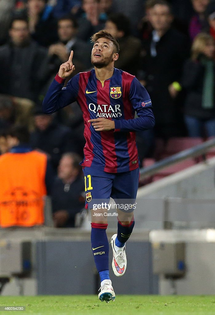 Neymar of FC Barcelona celebrates scoring their second goal during the UEFA Champions League Group F match between FC Barcelona and Paris Saint-Germain FC at Camp Nou stadium on December 10, 2014 in Barcelona, Spain.