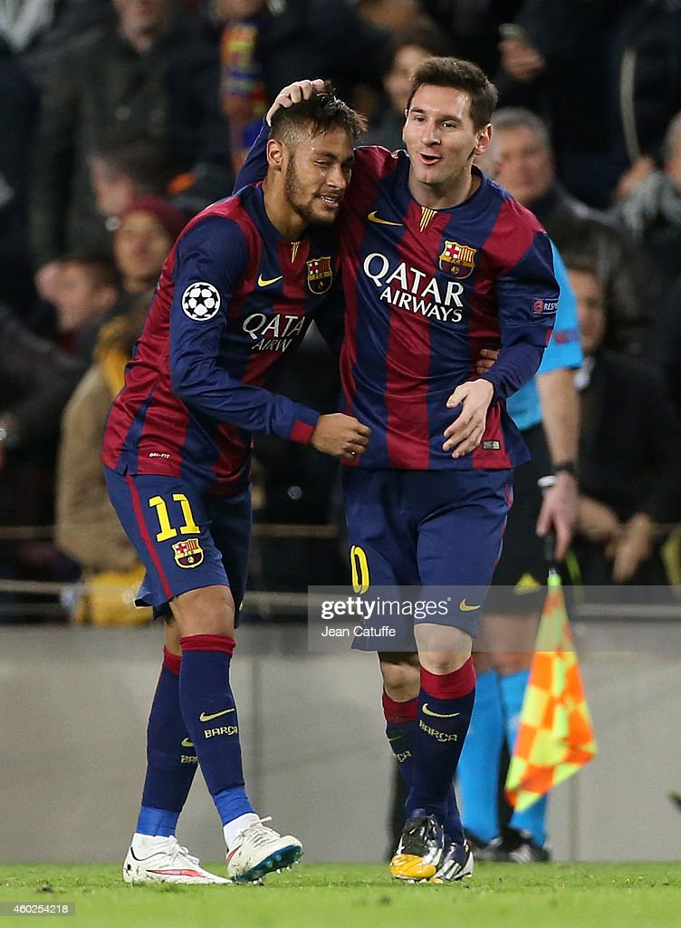 Neymar of FC Barcelona celebrates scoring their second goal with Lionel Messi of FC Barcelona during the UEFA Champions League Group F match between FC Barcelona and Paris Saint-Germain FC at Camp Nou stadium on December 10, 2014 in Barcelona, Spain.