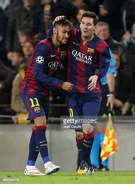 Neymar of FC Barcelona celebrates scoring their second goal with Lionel Messi of FC Barcelona during the UEFA Champions League Group F match between...