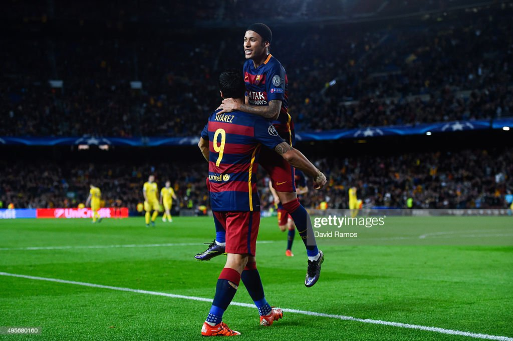 Neymar (R) of FC Barcelona celebrates with his team mate Luis Suarez after scoring his team's third goalduring the UEFA Champions League Group E match between FC Barcelona and FC BATE Borisov at the Camp Nou on November 4, 2015 in Barcelona, Spain.