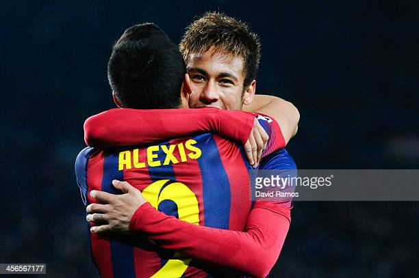 Neymar of FC Barcelona celebrates with his teammate Alexis Sanchez of FC Barcelona after scoring his team's second goal during the La Liga match...