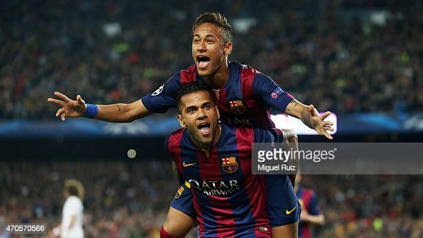 Neymar of FC Barcelona celebrates with his teammate Dani Alves as he scored the second goal during the UEFA Champions League 1/4 2nd leg match...