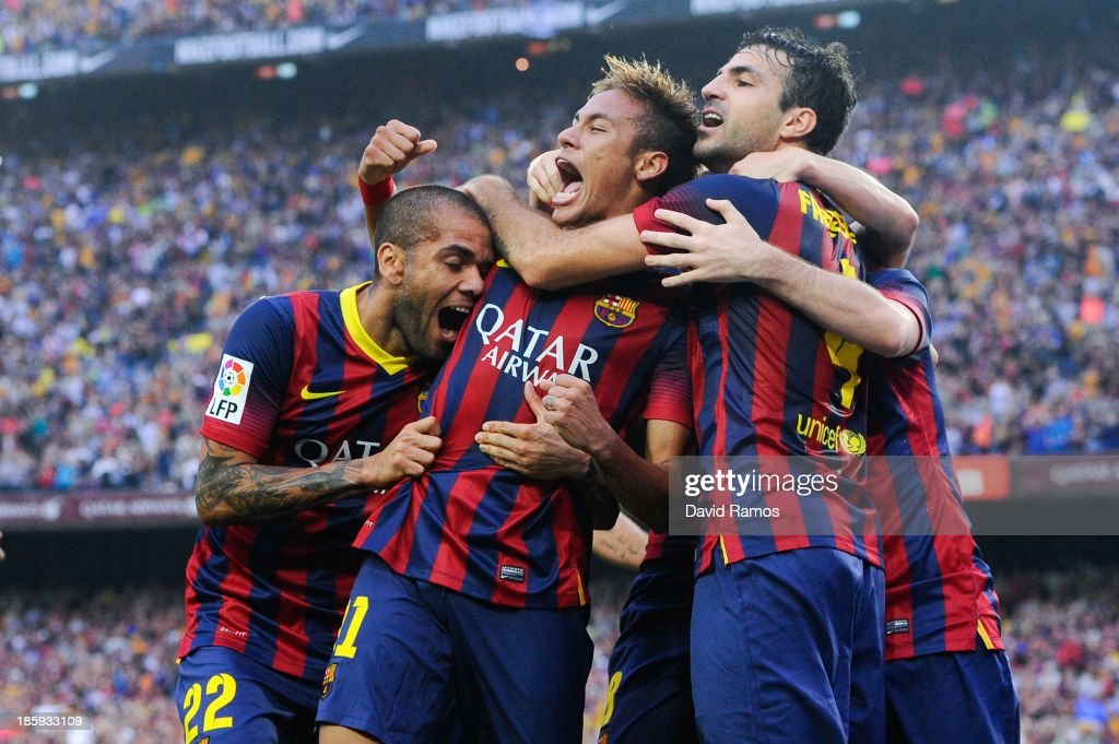 Neymar (C) of FC Barcelona celebrates with his team-mates after scoring the opening goal during the La Liga match between FC Barcelona and Real Madrid CF at Camp Nou on October 26, 2013 in Barcelona, Spain.