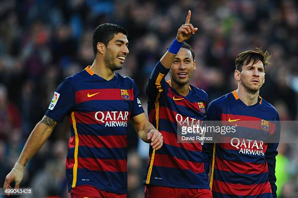 Neymar of FC Barcelona celebrates with his teammates Luis Suarez and Lionel Messi of FC Barcelonaa after scoring his team's third goal of FC...