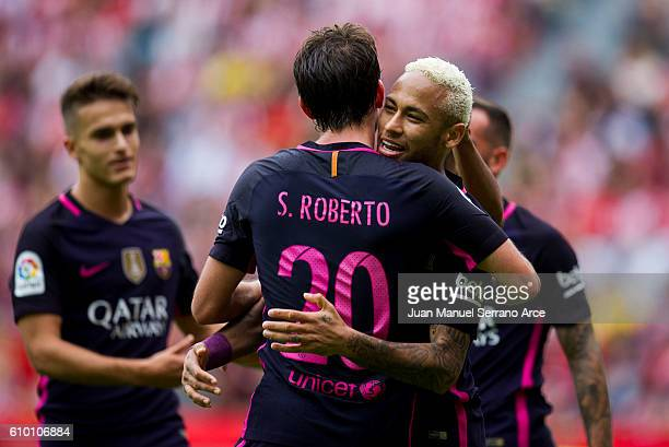 Neymar of FC Barcelona celebrates with his teammates Sergi Roberto Carnicer of FC Barcelona after scoring his team's third goal during the La Liga...