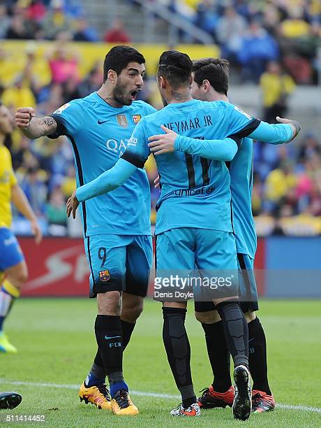 Neymar of FC Barcelona celebrates with Lionel Messi and Luis Suarez after scoring his team's 2nd goal during the La Liga match between UD Las Palmas...