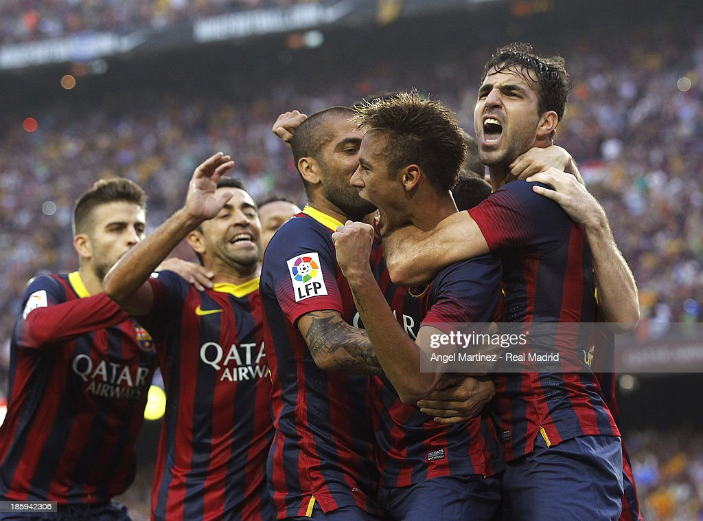 Neymar (2nd R) of FC Barcelona celebrates with team-mates after scoring the opening goal of the La Liga match between FC Barcelona and Real Madrid at Camp Nou on October 26, 2013 in Barcelona, Spain.