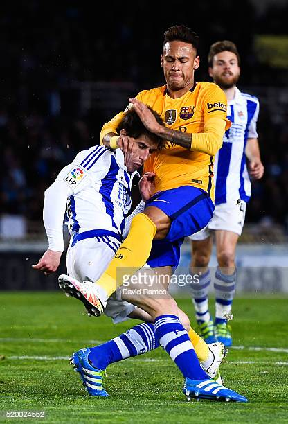 Neymar of FC Barcelona clashes with Elustondo of Real Sociedad de Futbol during the La Liga match between Real Sociedad de Futbol and FC Barcelona at...