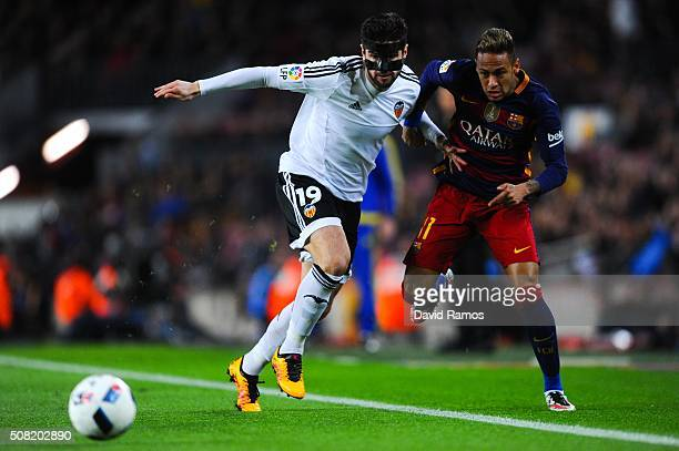 Neymar of FC Barcelona competes for the ball with Antonio Barragan of Valencia CF during the Copa del Rey Semi Final first leg match between FC...