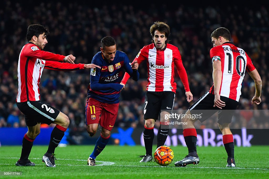 Neymar of FC Barcelona competes for the ball with Athletic Club de Bilbao players during the La Liga match between FC Barcelona and Athletic Club de Bilbao at Camp Nou on January 17, 2016 in Barcelona, Spain.