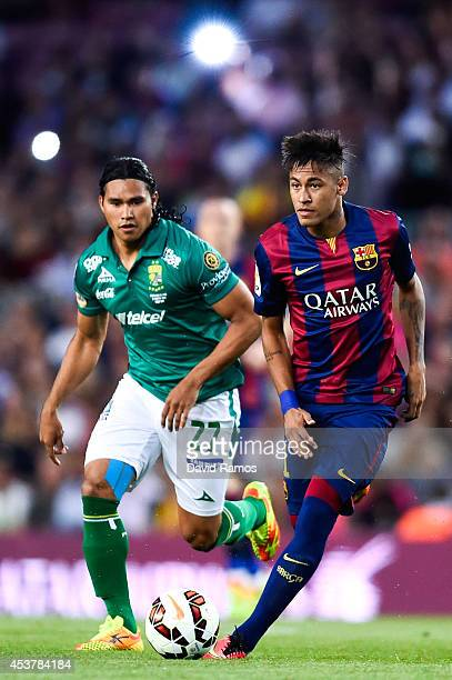 Neymar of FC Barcelona competes for the ball with Carlos Pena of Club Leon during the Joan Gamper Trophy match between FC Barcelona and Club Leon at...