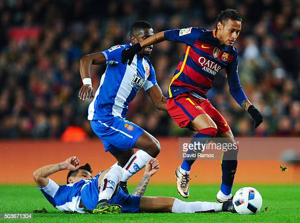 Neymar of FC Barcelona competes for the ball with Enzo Roco and Pape Diop of RCD Espanyol during the Copa del Rey Round of 16 first leg match between...