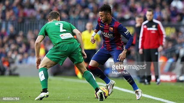 Neymar of FC Barcelona competes for the ball with Ivan Lopez of Levante UD during the La Liga match between FC Barcelona and Levante UD at Camp Nou...