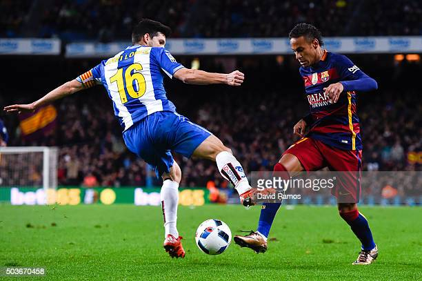 Neymar of FC Barcelona competes for the ball with Javi Lopez of RCD Espanyol during the Copa del Rey Round of 16 first leg match between FC Barcelona...