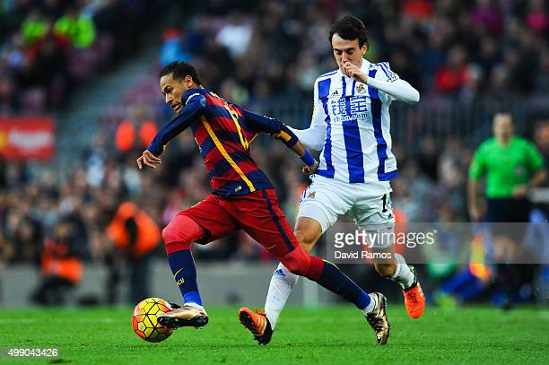 Neymar of FC Barcelona competes for the ball with Ruben Pardo of Real Sociedad during the La Liga match between FC Barcelona and Real Sociedad de...