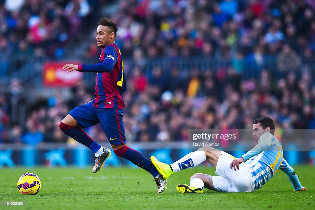 Neymar of FC Barcelona competes for the ball with Sergio P. Barbosa 'Duda' of Malaga CF during the La Liga match between FC Barcelona and Malaga CF at Camp Nou on February 21, 2015 in Barcelona, Spain.