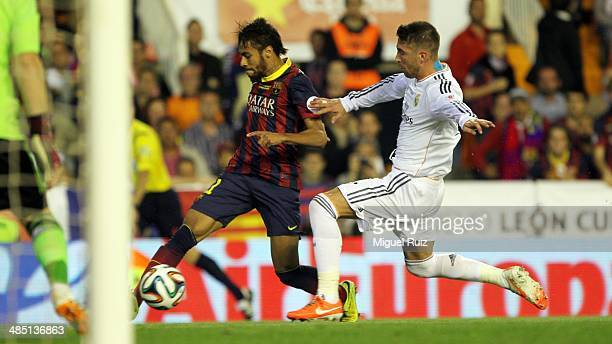 Neymar of FC Barcelona competes for the ball with Sergio Ramos of Real Madrid CF during the Copa del Rey Final between FC Barcelona and Real Madrid...