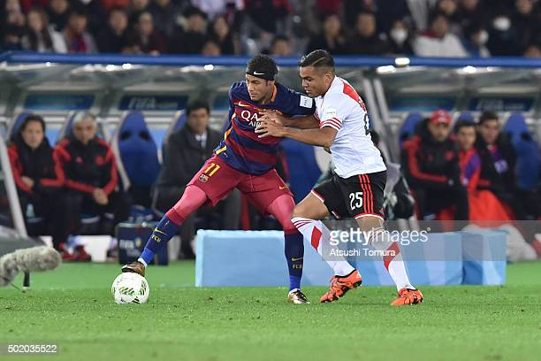 Neymar of FC Barcelona controls the ball against Gabriel Mercado of River Plate during the final match between River Plate and FC Barcelona at...