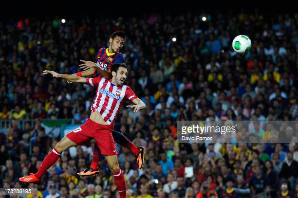 Neymar of FC Barcelona duels for a high ball with Juanfran of Atletico de Madrid during the Spanish Super Cup second leg match between FC Barcelona...