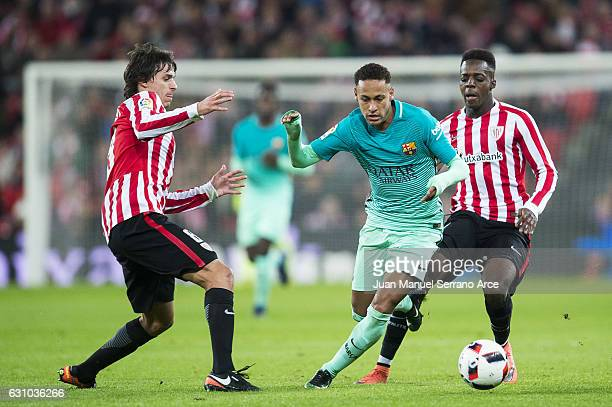 Neymar of FC Barcelona duels for the ball with Ander Iturraspe and Inaki Willams of Athletic Club during the Copa del Rey Round of 16 first leg match...