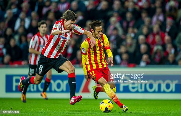 Neymar of FC Barcelona duels for the ball with Ander Iturraspe of Athletic Club during the La Liga match between Athletic Club and FC Barcelona at...