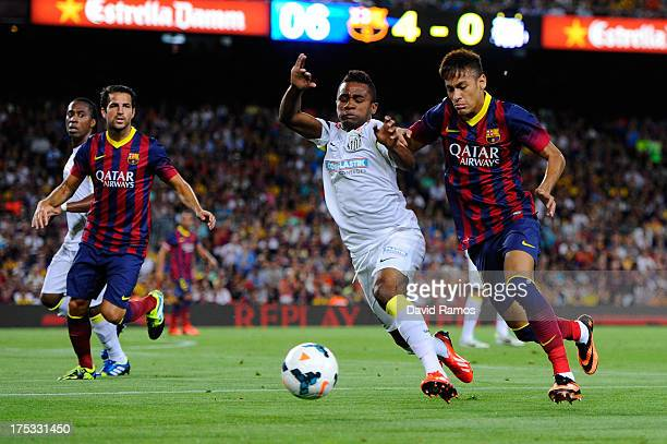 Neymar of FC Barcelona duels for the ball with Cicinho of Santos during a friendly match between FC Barcelona and Santos at Nou Camp on August 2,...