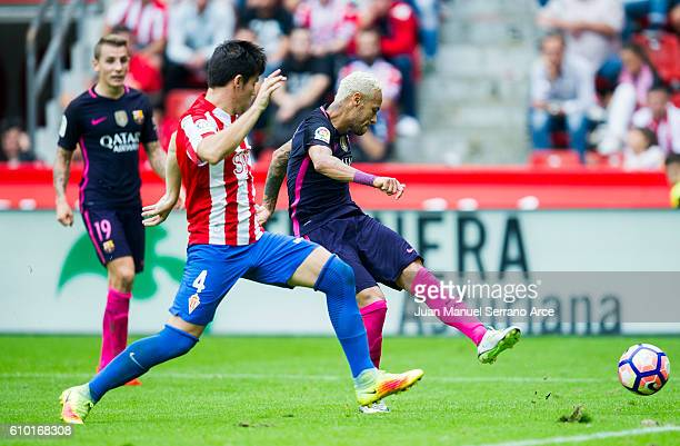 Neymar of FC Barcelona duels for the ball with Jorge Mere of Real Sporting de Gijon during the La Liga match between Real Sporting de Gijon and FC...
