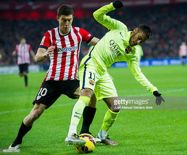 Neymar of FC Barcelona duels for the ball with Oscar De Marcos of Athletic Club during the La Liga match between Athletic Club and FC Barcelona at...