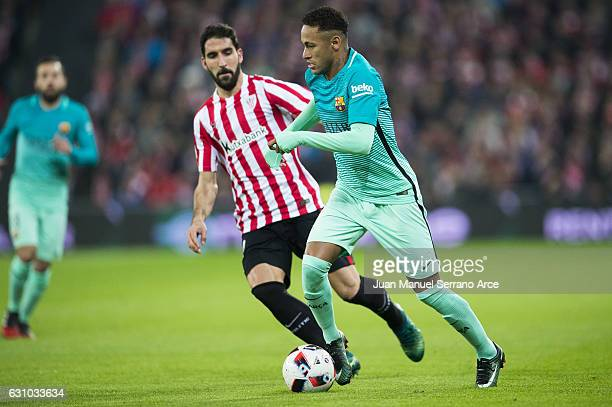 Neymar of FC Barcelona duels for the ball with Raul Garcia of Athletic Club during the Copa del Rey Round of 16 first leg match between Athletic Club...