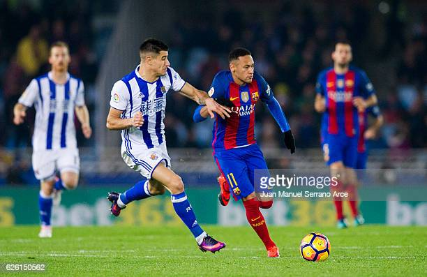 Neymar of FC Barcelona duels for the ball with Yuri Berchiche of Real Sociedad during the La Liga match between Real Sociedad de Futbol and FC...