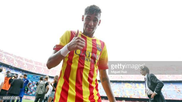 Neymar of FC Barcelona greets the camera after victory in the match between FC Barcelona and Athletic Club at Camp Nou on September 13 2014 in...