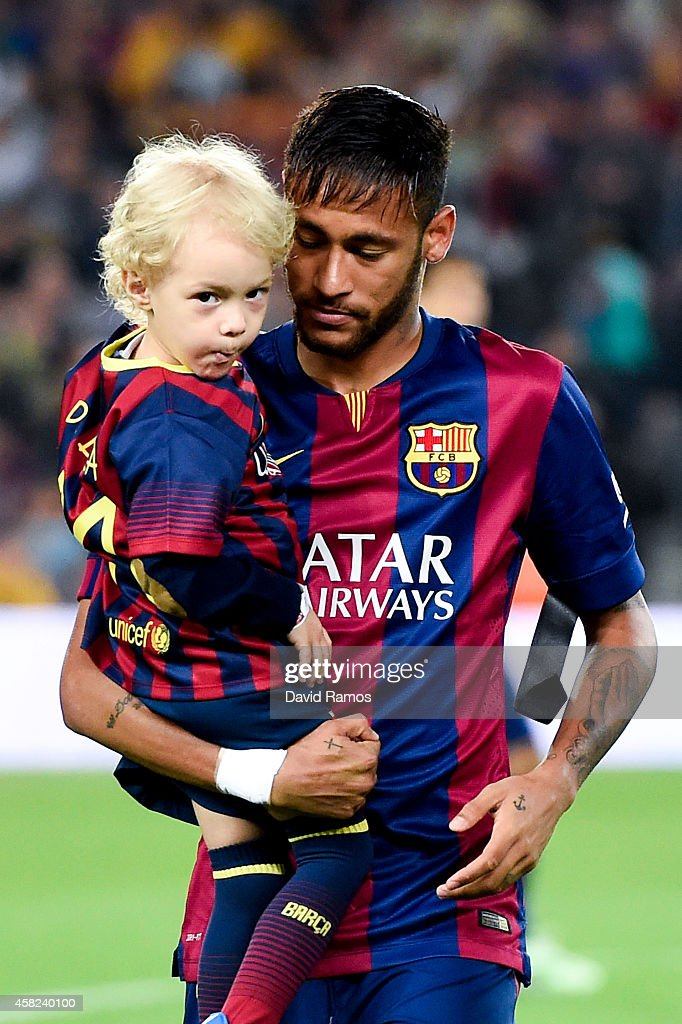 Neymar of FC Barcelona holds his son Davi Lucca during the La Liga match between FC Barcelona and Celta de Vigo at Camp Nou on November 1, 2014 in Barcelona, Spain.