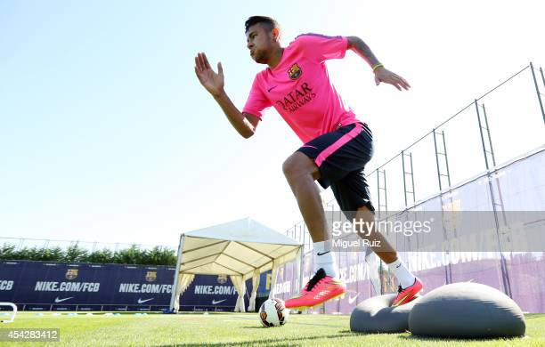 Neymar of FC Barcelona in action during FC Barcelona training at Ciutat Esportiva on August 27 2014 in Barcelona Spain