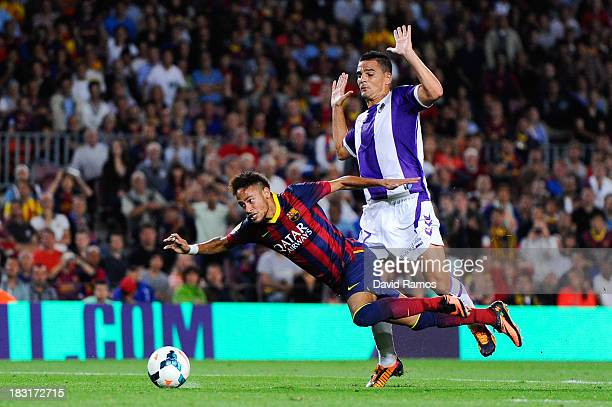 Neymar of FC Barcelona is brought down by Carlos Pena of Real Valladolid CF during the La Liga match between FC Barcelona and Real Valladolid CF at...