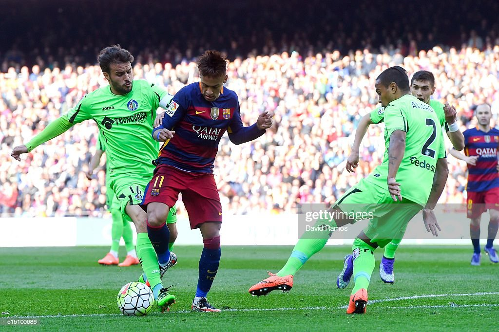 Neymar of FC Barcelona is brought down by Pedro Leon (L) of Getafe CF during the La Liga match between FC Barcelona and Getafe CF at Camp Nou on March 12, 2016 in Barcelona, Spain.