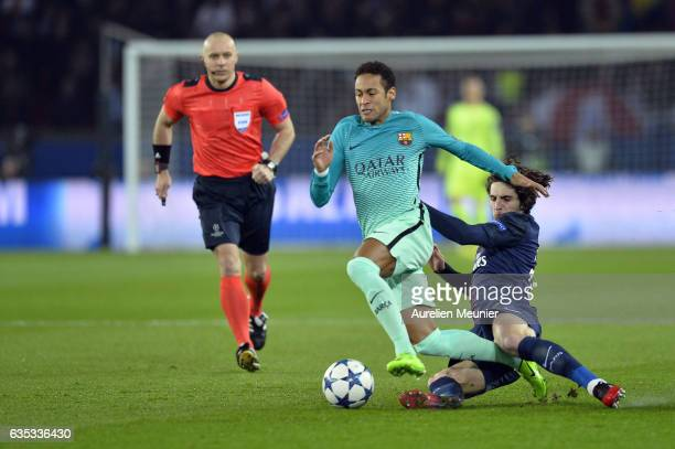 Neymar of FC Barcelona is tackled by Adrien Rabiot of ParisSaint Germain during the UEFA Champions League Round of 16 first leg match between Paris...