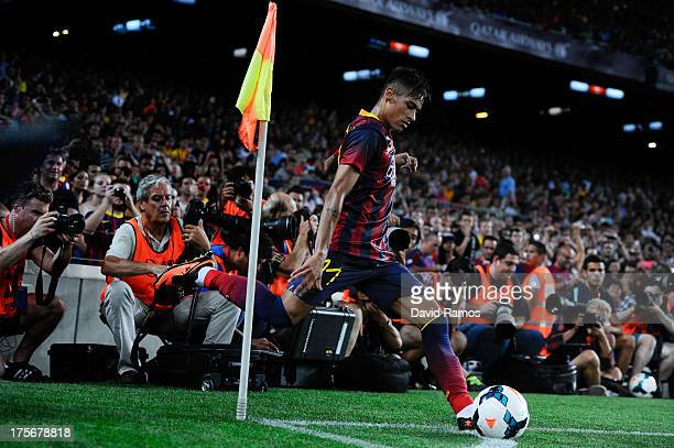 Neymar of FC Barcelona kicks a corner during a friendly match between FC Barcelona and Santos at Nou Camp on August 2 2013 in Barcelona Spain