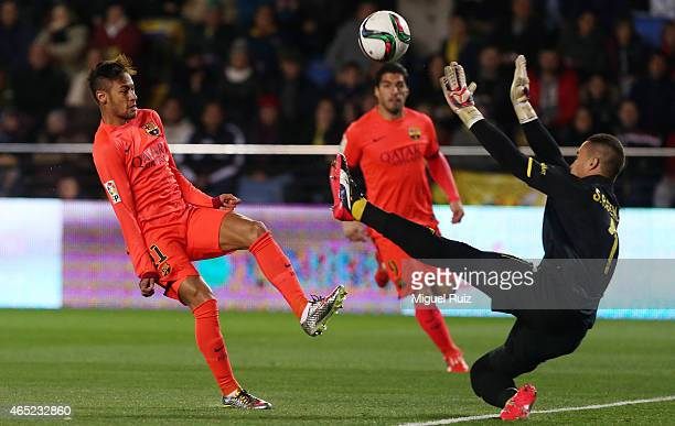 Neymar of FC Barcelona kicks the ball and scores the first goal during the Copa del Rey semifinal second leg match between Villarreal CF and FC...