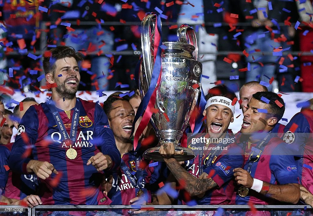 Neymar of FC Barcelona lifts the trophy following the UEFA Champions League Final match between Juventus and FC Barcelona at the Olympiastadion on June 6, 2015 in Berlin, Germany.