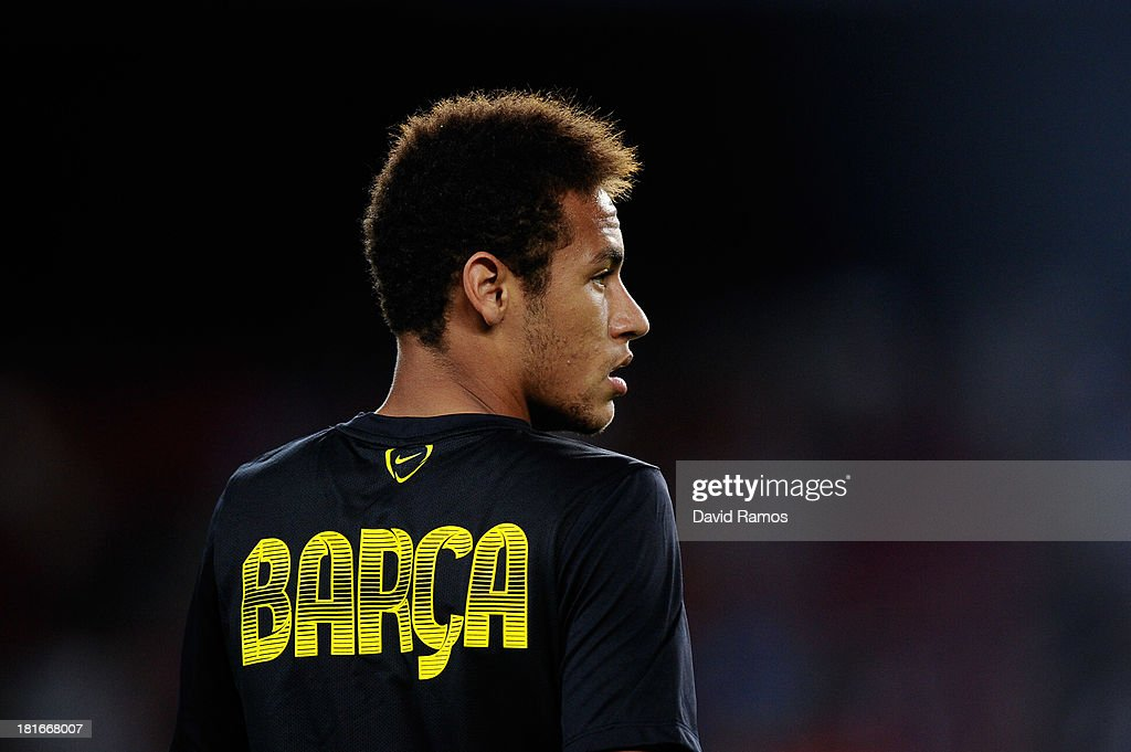 Neymar of FC Barcelona looks on during the warm up session prior to the UEFA Champions League Group H match between FC Barcelona and Ajax Amsterdam at the Camp Nou stadium on September 18, 2013 in Barcelona, Spain.