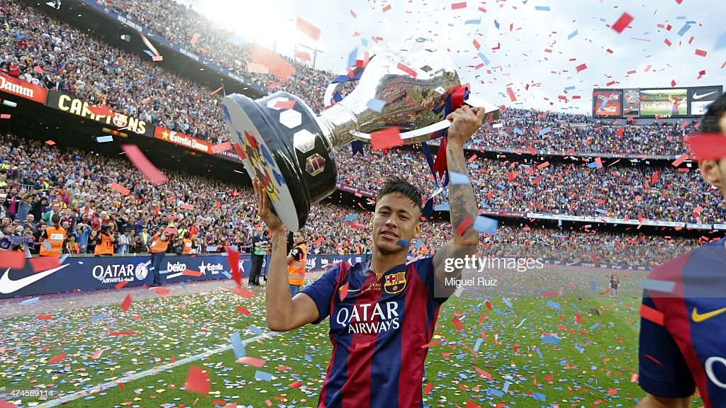 Neymar of FC Barcelona poses with La Liga trophy during the La Liga match between FC Barcelona and RC Deportivo La Coruña at Camp Nou on May 23, 2015 in Barcelona, Spain.